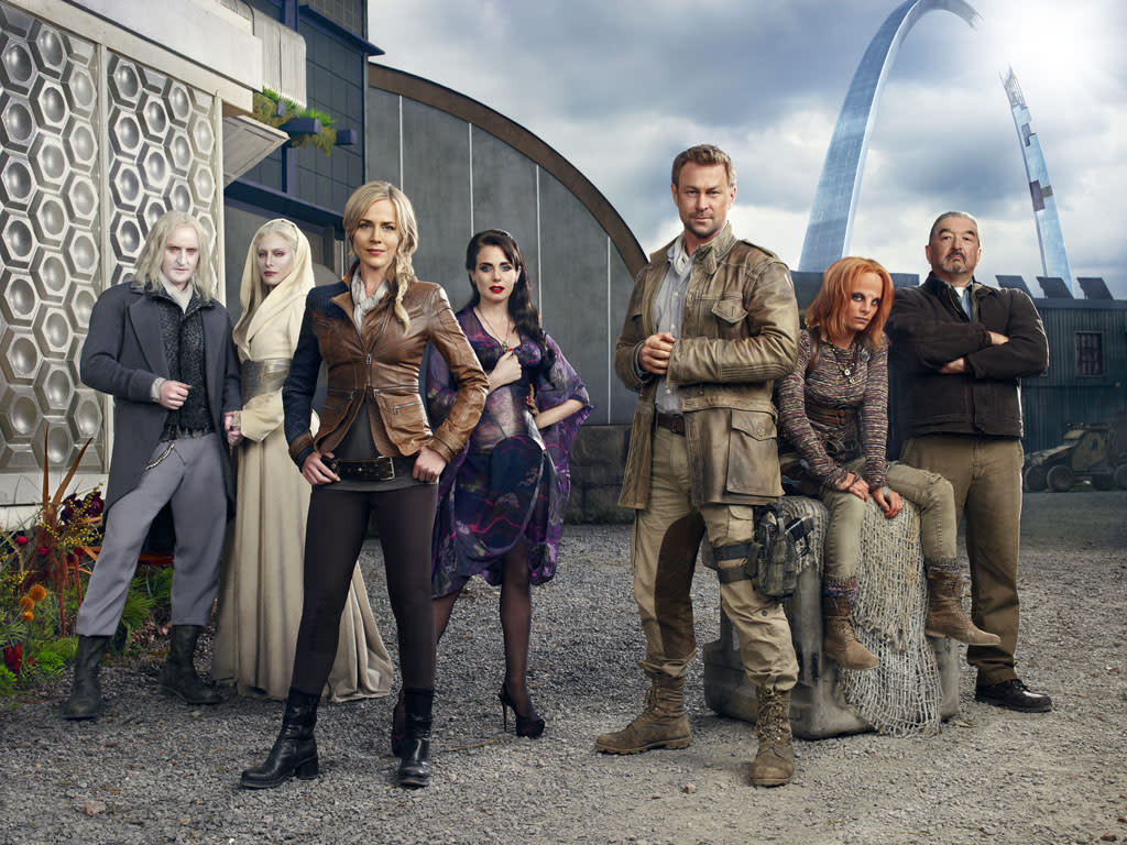 "Tony Curran as Datak Tarr, Jaime Murray as Stahma Tarr, Julie Benz as Amanda Rosewater, Mia Kirshner as Kenya Rosewater, Grant Bowler as Joshua Nolan, Stephanie Leonidas as Irisa Nyira and Graham Greene as Rafe McCawley on Syfy's ""Defiance."""