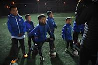 China has made improving youth football programmes a national priority, with an official plan promising 20,000 academies and 30 million elementary and middle school pupils playing the sport within four years (AFP Photo/Greg Baker)