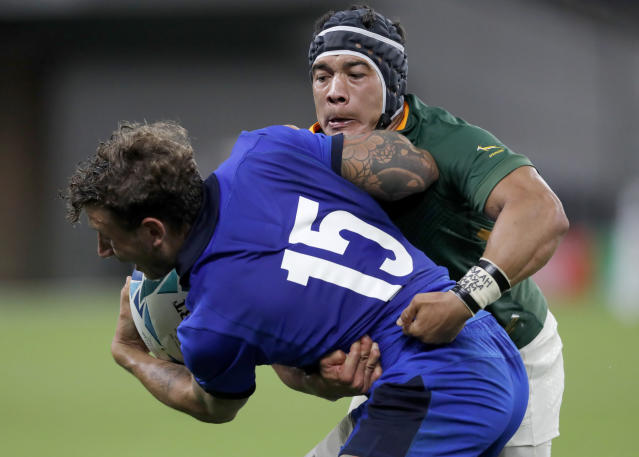 South Africa's Cheslin Kolbe, right, tackles Italy's Matteo Minozzi during the Rugby World Cup Pool B game at Shizuoka Stadium Ecopa between South Africa and Italy in Shizuoka, Japan, Friday, Oct. 4, 2019. South Africa defeated Italy 49-3. (AP Photo/Shuji Kajiyama)