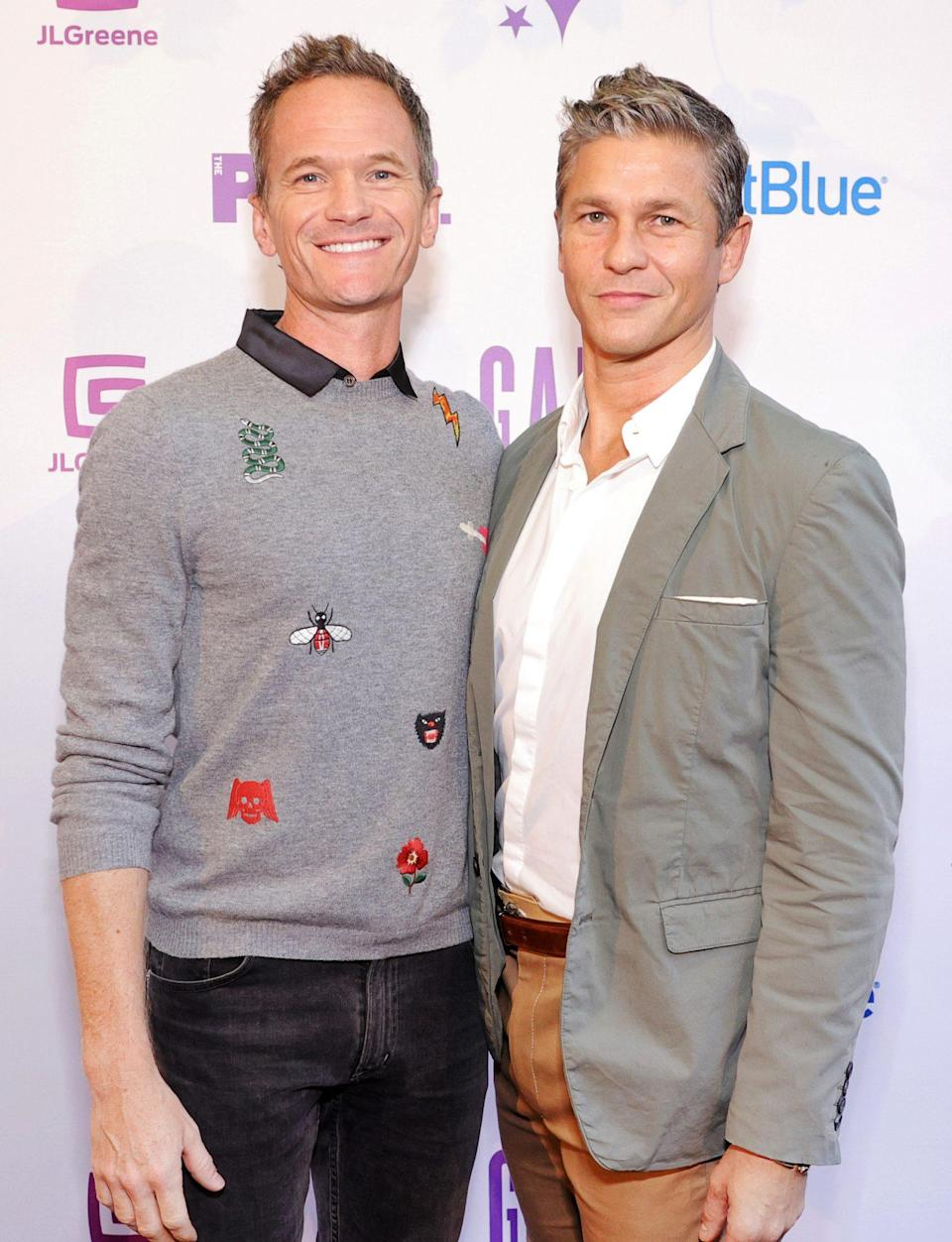 <p>Neil Patrick Harris and David Burtka coordinate in shades of gray on Sept. 20 at The Public Theater's 2021 annual gala at the Delacorte Theater in New York City's Central Park.</p>