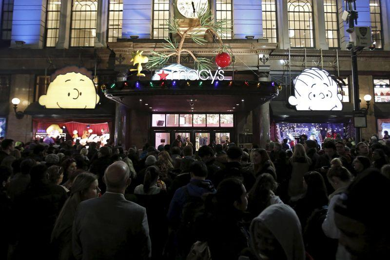 Shoppers wait to enter Macy's Herald Square store during the early opening of the Black Friday sales in the Manhattan borough of New York