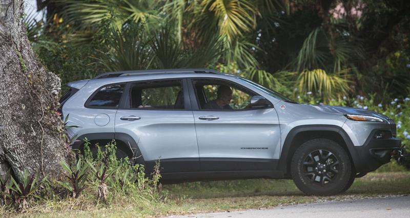 Leonard Forte repositioning a vehicle outside his home in September. Medical records he submitted to the court in 2017, when he claimed he had six months to live, stated that he is unable to drive.