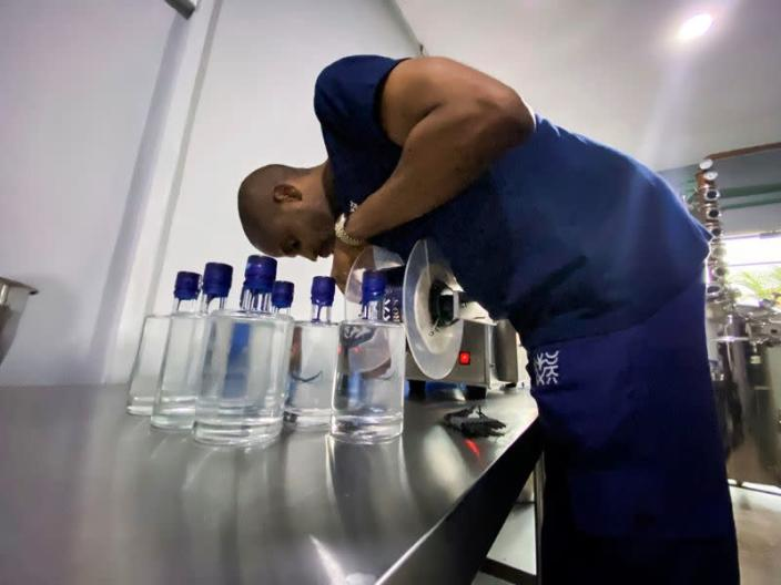 Chibueze Akukwe, co-founder of Pedro's gin distillery is seen fixing a tool during a production in Lagos