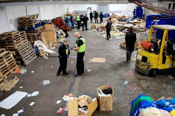 The police raid at one of the recycling plants.