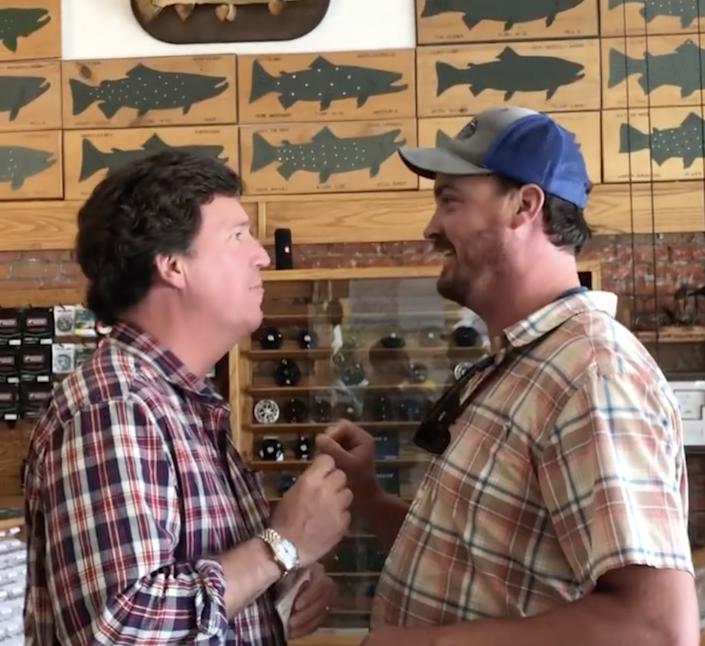 A man posted a video of himself telling Tucker Carlson that he was 'the worst person alive' in a fishing goods store in Montana (Dan Bailey)