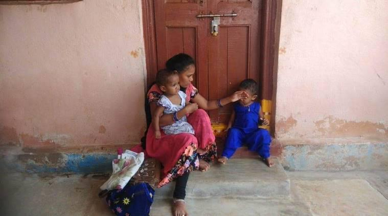 K Bharathi with her two daughters outside her in-law's house. (Source: Sreenivas Janyala)