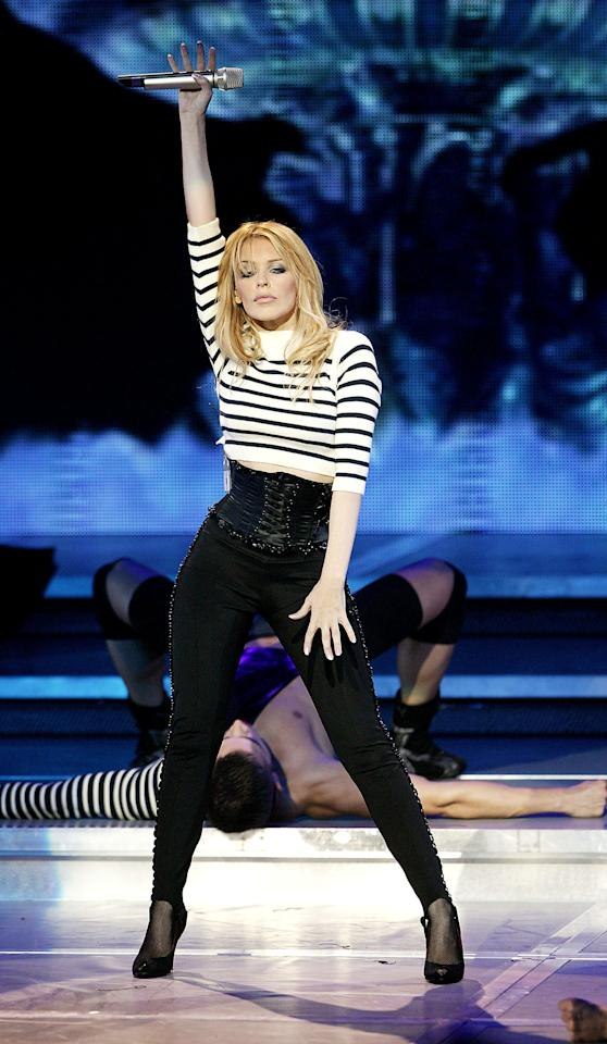 <p>Singer Kylie promoted her new album 'Body Language' performing live on stage at the Hammersmith Apollo on November 15, 2003 in London. Source: Getty </p>