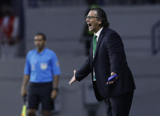 Saudi Arabia's head coach Juan Antonio Pizzi, reacts as he directs his players, during the AFC Asian Cup group E soccer match between Lebanon and Saudi Arabia at Al Maktoum Stadium in Dubai, United Arab Emirates, Saturday, Jan. 12, 2019. (AP Photo/Hassan Ammar)