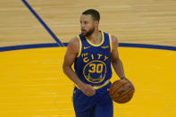 Golden State Warriors guard Stephen Curry (30) dribbles against the Utah Jazz during the second half of an NBA basketball game in San Francisco, Monday, May 10, 2021. (AP Photo/Jeff Chiu)