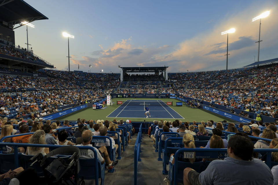 Felix Auger-Aliassime, far, of Canada, returns to Stefanos Tsitsipas, near, of Greece, during the Western & Southern Open tennis tournament Friday, Aug. 20, 2021, in Mason, Ohio. (AP Photo/Aaron Doster)