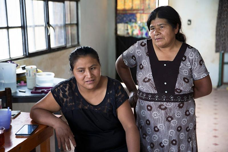 Roberto Tecpile's wife, Verónica Montalvo, and his mother, Concepciona Acahua, put the money he sends from his job in Wisconsin into the home the family is building in Astacinga, México.