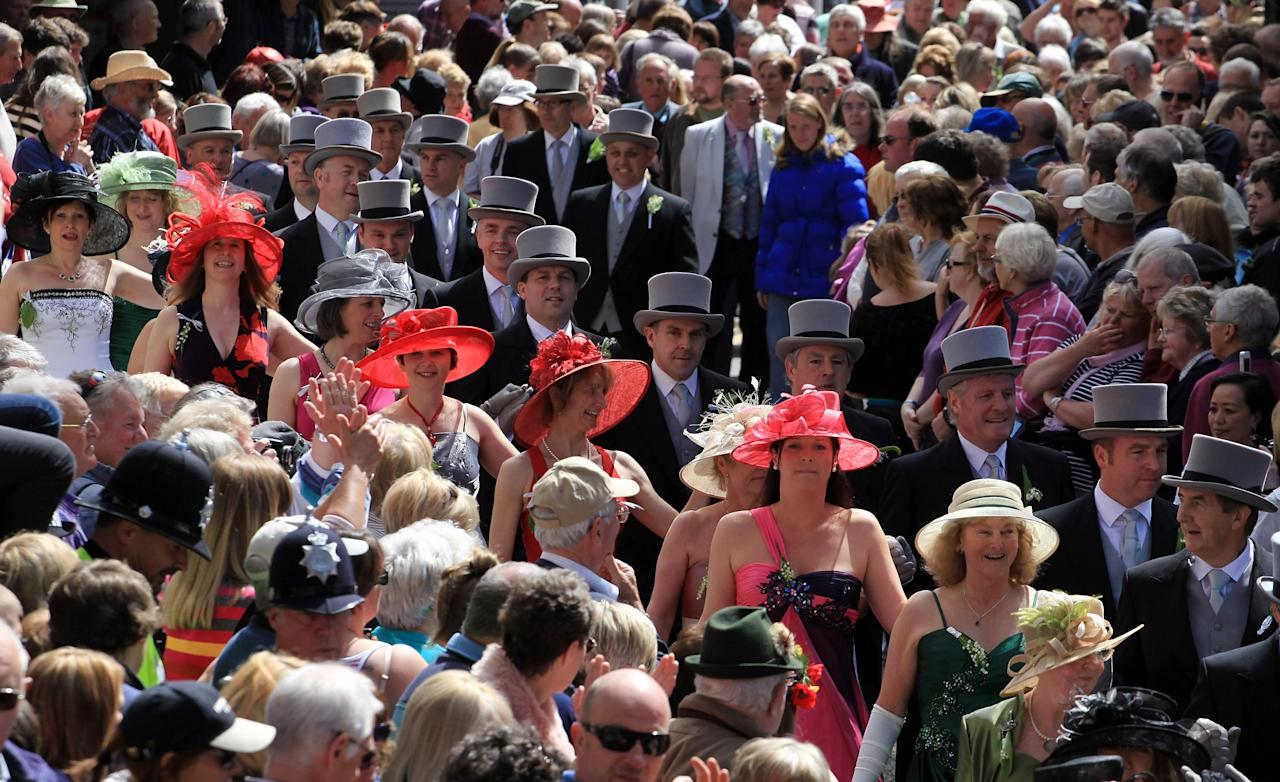 HELSTON, ENGLAND - MAY 08:  Participants in the Flora Dance make their way through the town as they celebrate Helston Flora Day on May 8, 2012 in Helston, England. The Flora Dance, also known as the Furry Dance, is one of the UK's oldest customs still practised today and is said to be a celebration of the passing of Winter and the arrival of Spring. The Flora Dance, also known as the Furry Dance, is one of the UK's oldest customs still practised today and is said to be a celebration of the passing of Winter and the arrival of Spring. A series of dances take place throughout the day, beginning at 7am, all over the town and even in and out of private houses and shops. However the highlight is the midday dance which was traditionally the dance of the gentry in the town and is why men still wear top hats and tails while the women dance in their finest dresses. (Photo by Matt Cardy/Getty Images)