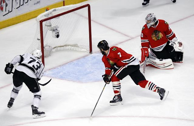 Los Angeles Kings center Tyler Toffoli (73) scores a goal against Chicago Blackhawks defenseman Brent Seabrook (7)and goalie Corey Crawford (50) during the second period in Game 7 of the Western Conference finals in the NHL hockey Stanley Cup playoffs Sunday, June 1, 2014, in Chicago. (AP Photo/Charles Rex Arbogast)