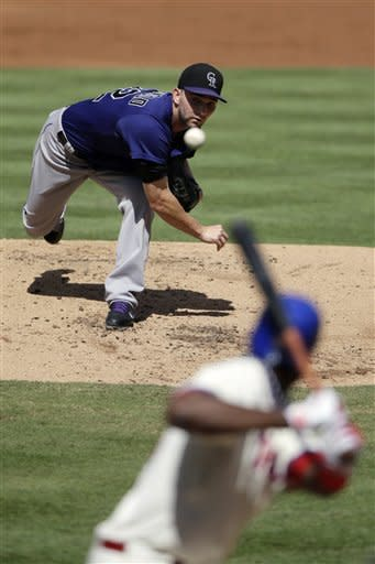 Colorado Rockies' Tyler Chatwood pitches against Philadelphia Phillies' John Mayberry Jr. in the first inning of the first game of a baseball doubleheader on Sunday, Sept. 9, 2012, in Philadelphia. (AP Photo/Matt Slocum)