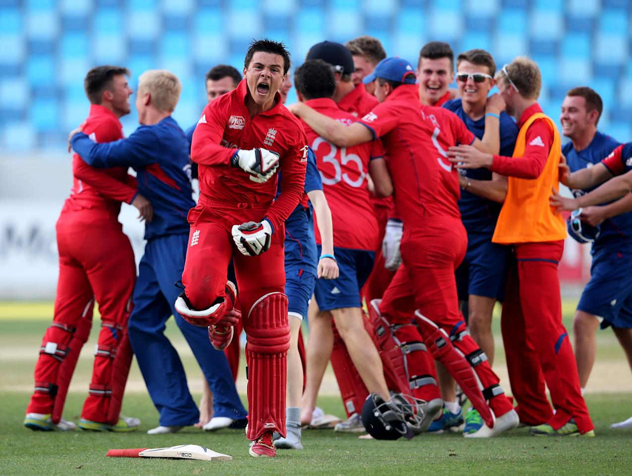 DUBAI, UNITED ARAB EMIRATES - FEBRUARY 22:  Robert Jones of England celebrates with teammates after winning the ICC U19 Cricket World Cup 2014 Quarter Final match between England and India at the Dubai Sports City Cricket Stadium on February 22, 2014 in Dubai, United Arab Emirates.  (Photo by Francois Nel - IDI/IDI via Getty Images)