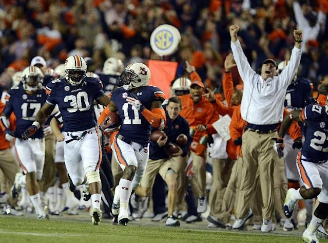Auburn cornerback Chris Davis (11) returns a missed field-goal attempt more than 100 yards for a touchdown on the final play of an NCAA college football game against Alabama in Auburn, Ala., Saturday, Nov. 30, 2013. (AP Photo/Montgomery Advertiser, Amanda Sowards)