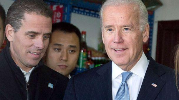 PHOTO: Vice President Joe Biden, center, buys an ice-cream at a shop as he tours a Hutong alley with his granddaughter Finnegan Biden, right, and son Hunter Biden, left, in Beijing, China, Dec. 5, 2013. (Andy Wong/AP, Pool)