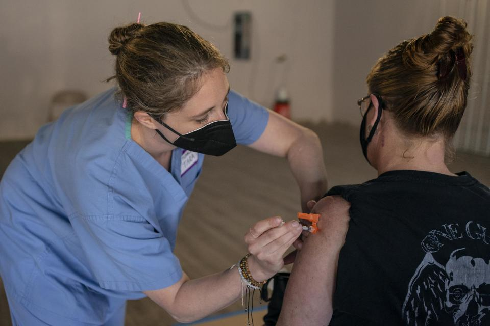 Nurse practitioner Tara Biller administers a COVID-19 vaccination during the Joints4Jabs COVID-19 vaccination clinic, hosted by Pliable, at the Uncle Ikes White Center cannabis shop on June 16, 2021 in Seattle, Washington. (David Ryder/Getty Images)