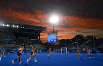 <p>Players from South Africa and Britain compete during the women's pool A match of the field hockey competition on July 26.</p>