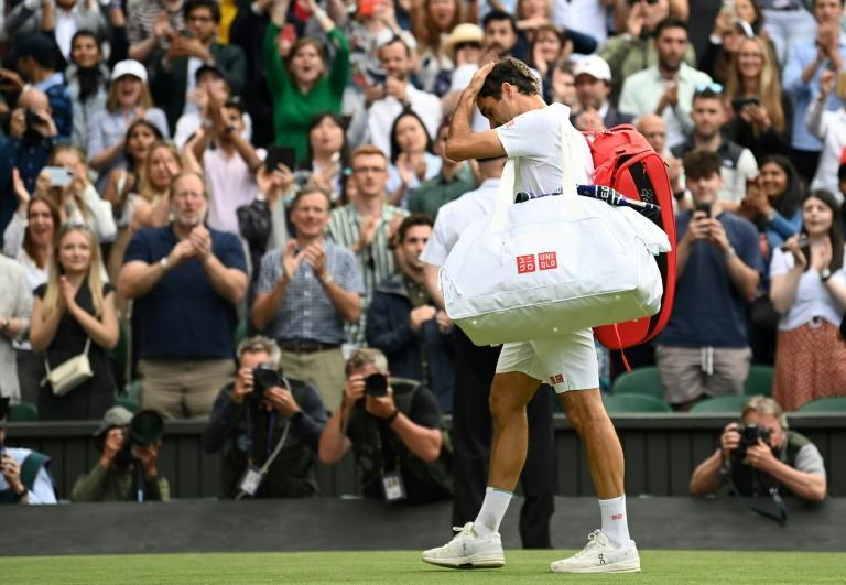 The end? Roger Federer leaves the court after losing to Poland's Hubert Hurkacz