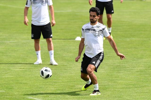 German national football team midfielder Ilkay Gundogan admits being shocked by the level of criticism he and Mesut Ozil received after posing for pictures with Turkey president Recep Tayyip Erdogan. (AFP Photo/MIGUEL MEDINA)