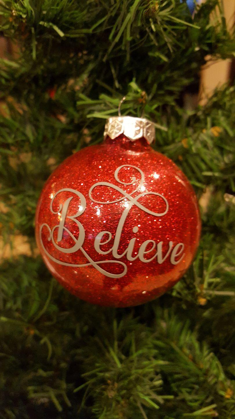 """<p>Round or flat disc-shaped ornaments work equally well for this simple, pretty ornament with a holiday-themed word or phrase. </p><p><strong>Get the tutorial at <a href=""""https://leapoffaithcrafting.com/diy-glitter-ornament-tutorial/"""" rel=""""nofollow noopener"""" target=""""_blank"""" data-ylk=""""slk:Leap of Faith Crafting"""" class=""""link rapid-noclick-resp"""">Leap of Faith Crafting</a>.</strong></p><p><a class=""""link rapid-noclick-resp"""" href=""""https://www.amazon.com/Creative-Hobbies-Ornament-3-15-Inch-Diameter/dp/B00G6RJ75A/?tag=syn-yahoo-20&ascsubtag=%5Bartid%7C10050.g.28831556%5Bsrc%7Cyahoo-us"""" rel=""""nofollow noopener"""" target=""""_blank"""" data-ylk=""""slk:SHOP DISC-SHAPED ORNAMENTS"""">SHOP DISC-SHAPED ORNAMENTS</a></p>"""