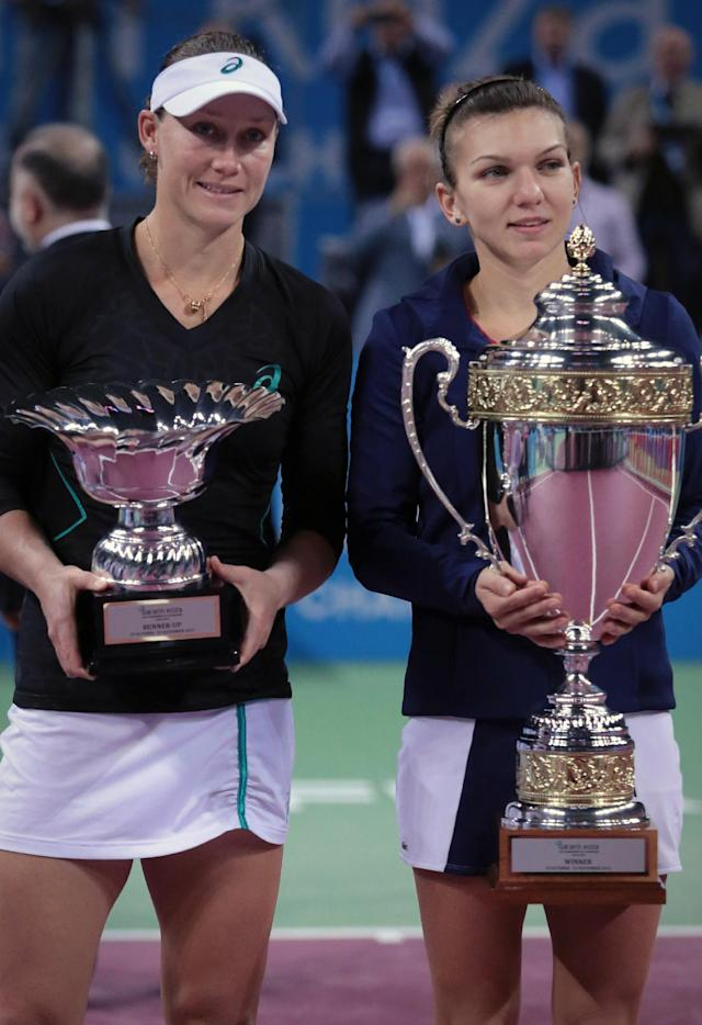 Simona Halep of Romania, right holds her trophy after defeating Samantha Stosur of Australia, left, at the awarding ceremony on the final of the WTA Tournament of the Champions in Sofia, Bulgaria, Sunday, Nov. 3, 2013. (AP Photo/ Valentina Petrova)