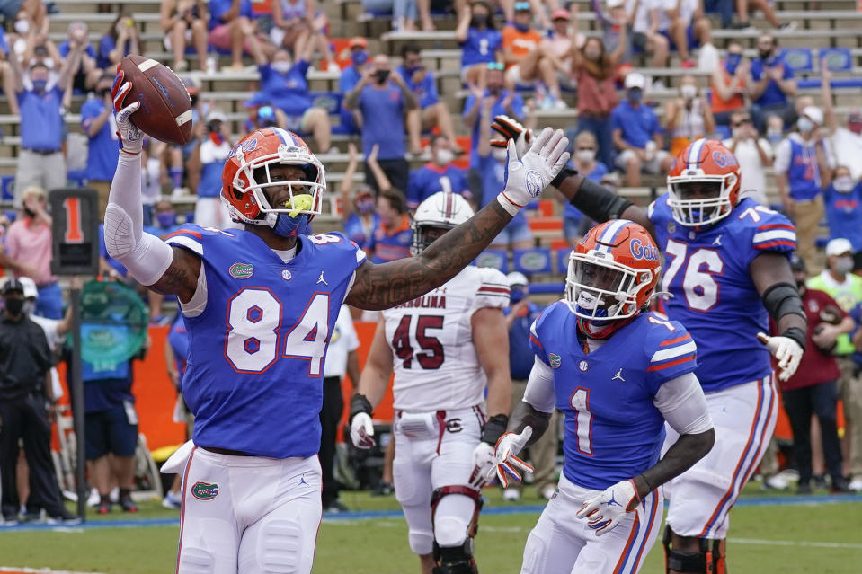 Florida tight end Kyle Pitts (84) celebrates a 4-yard touchdown catch against South Carolina during the first half of an NCAA college football game, Saturday, Oct. 3, 2020, in Gainesville, Fla. (AP Photo/John Raoux, Pool)