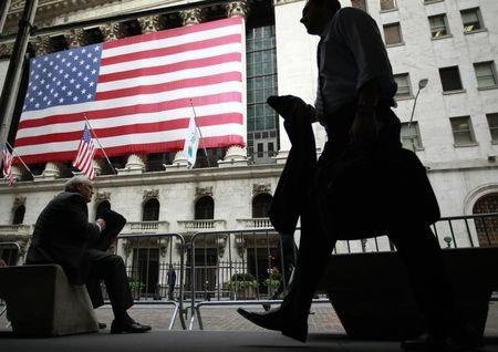Morning commuters are seen outside the New York Stock Exchange