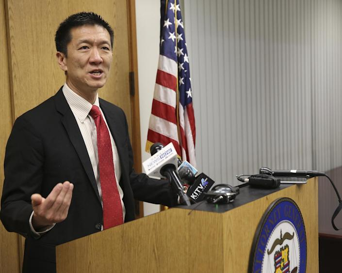 FILE - In this March 9, 2017, file photo, Hawaii Attorney General Douglas Chin speaks at a news conference in Honolulu. The day before it is supposed to go into effect President Donald Trump's revised travel ban will be scrutinized in federal courtrooms across the country on Wednesday, March 15. Hawaii will argue that the new order will harm its Muslim population, tourism and foreign students. (AP Photo/Marco Garcia, File)