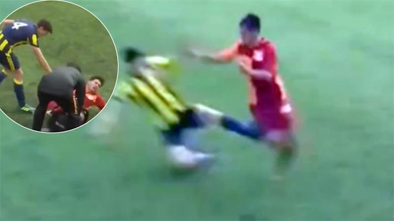 This brutal tackle rocked the Fenerbahce v Galatasaray U/17 game. Pic: FBTV