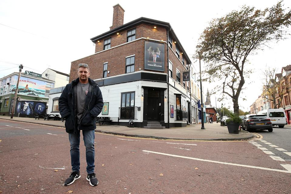 NEW BRIGHTON, ENGLAND - OCTOBER 14: (EDITORS NOTE. Image contains offensive language.) Daniel Davies, owner of 'The James Atherton' pub, poses for a photograph after he changes it's name to 'The Three Bellends' on October 14, 2020 in Liverpool, England. The Liverpool City Region was placed into the highest tier of the government's new three-tier system to assess Covid-19 risk, a designation which forced the area to close pubs and ban household mixing from today, among other restrictions. (Photo by Lewis Storey/Getty Images)
