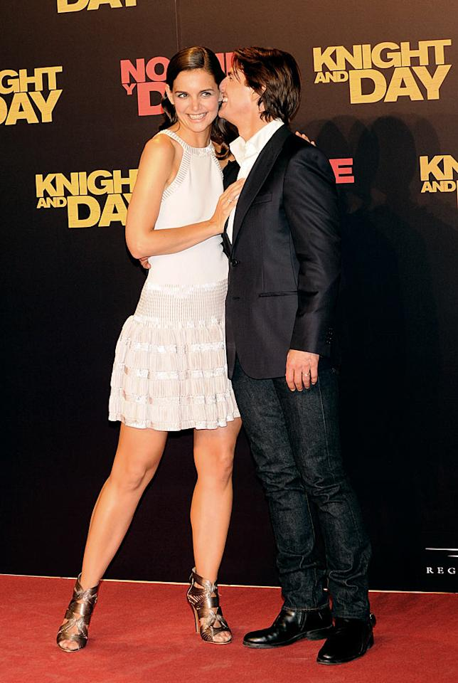 """<i>Star</i> reports Tom Cruise and Katie Holmes' relationship is in trouble. According to the magazine, the couple signed a """"marriage contract"""" that both have broken. <i>Star</i> says Cruise is upset because he guaranteed Holmes $10 million for a second baby, but she's stalling. And Holmes is angry because Cruise """"promised"""" her a role in """"Mission: Impossible 4,"""" but """"never followed through."""" For exclusive scoop on the secret contract, click over to <a href=""""http://www.gossipcop.com/tom-cruise-katie-holmes-marriage-deal-contract-second-baby-fight/"""" target=""""new"""">Gossip Cop</a>. Fotonoticias/<a href=""""http://www.wireimage.com"""" target=""""new"""">WireImage.com</a> - June 16, 2010"""