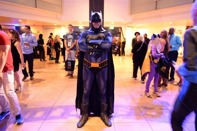 DC fans at the Batman Experience exhibit at Comic Con Museum on July 17, 2019, in San Diego. This guy probably has high self-esteem. (Photo: Andrew Toth via Getty Images)