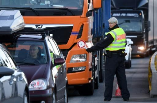 Motorists were forced to wait up to an hour, with police under orders to turn back any drivers without a 'particular reason' to cross
