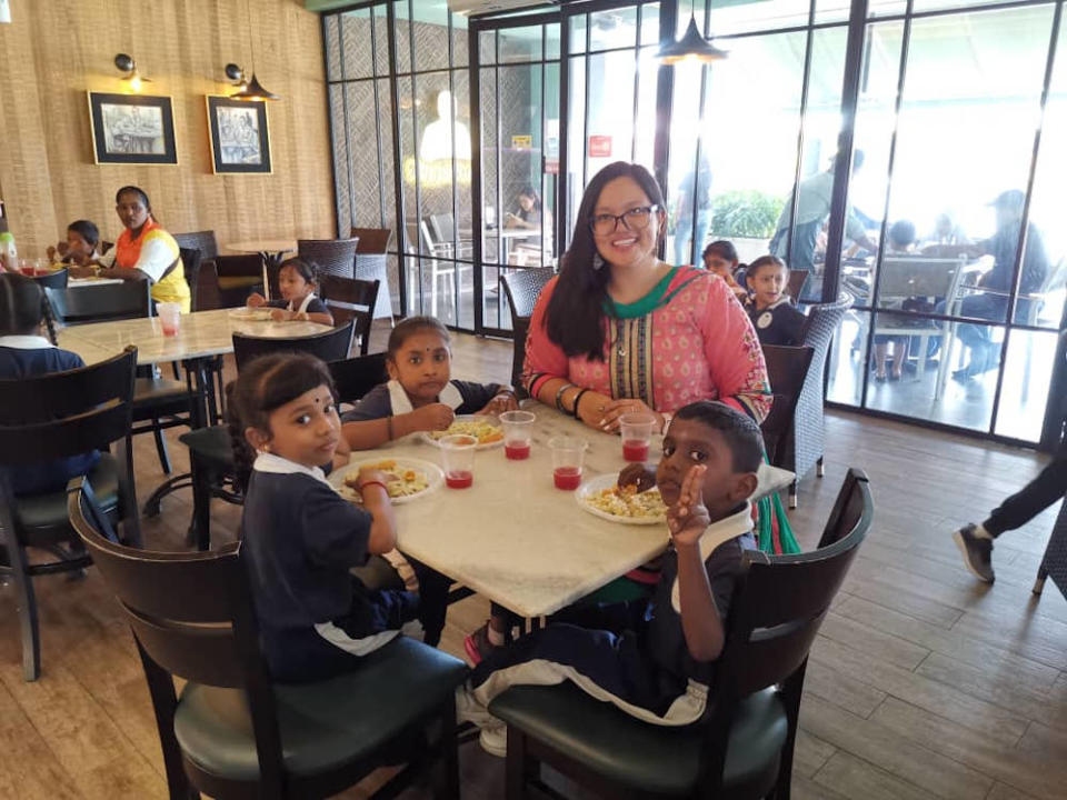 Melissa bringing out children of plantation workers for a Deepavali brunch treat in 2019. — Picture courtesy of Melissa Mohan Tyndall