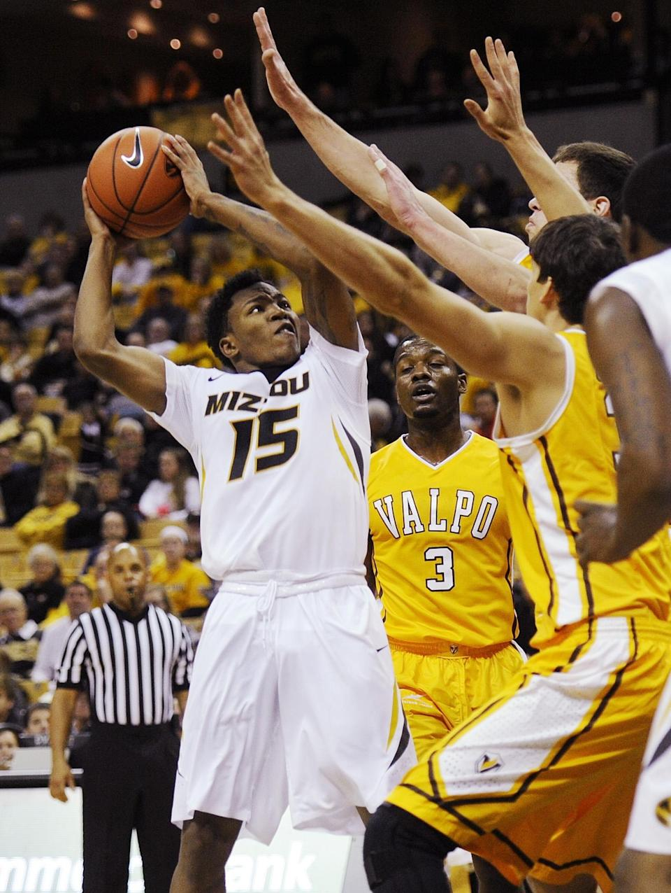 Missouri's Wes Clark, left, shoots over several Valparaiso players during the first half of an NCAA college basketball game Sunday, Nov. 16, 2014, in Columbia, Mo. (AP Photo/L.G. Patterson)