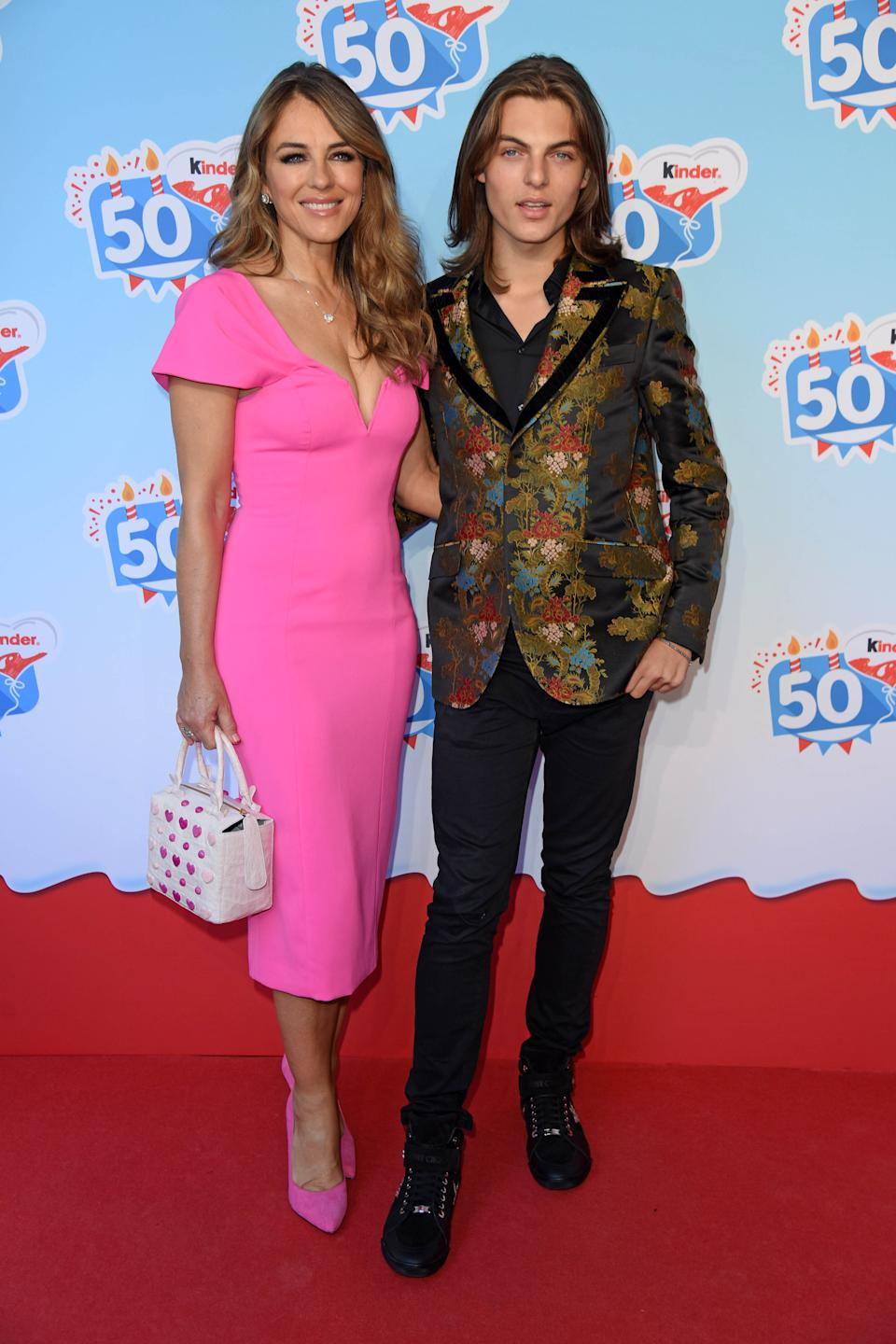 SOLTAU, GERMANY - OCTOBER 14: UK actress Elizabeth Liz Hurley and her son Damian Hurley during the 50th anniversary celebration of the brand Kinder (Ferrero) at Heidepark on October 14, 2018 in Soltau, Germany. (Photo by Tristar Media/Getty Images)