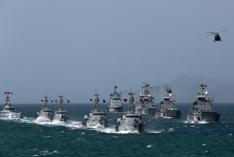 Venezuela said it would deploy naval vessels like these frigates - here on a 2019 exercise - to welcome Iranian tankers bringing much needed gasoline (AFP Photo/Zurimar CAMPOS)