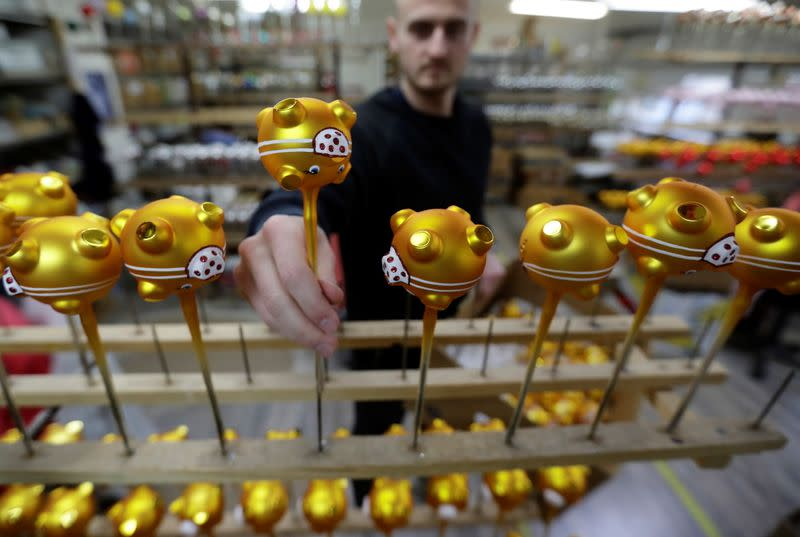 Masked Golden Pig Christmas tree decorations are made in Dvur Kralove nad Labem