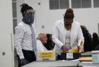 A person reviews ballots as votes continue to be counted at the TCF Center the day after the 2020 U.S. presidential election, in Detroit, Michigan