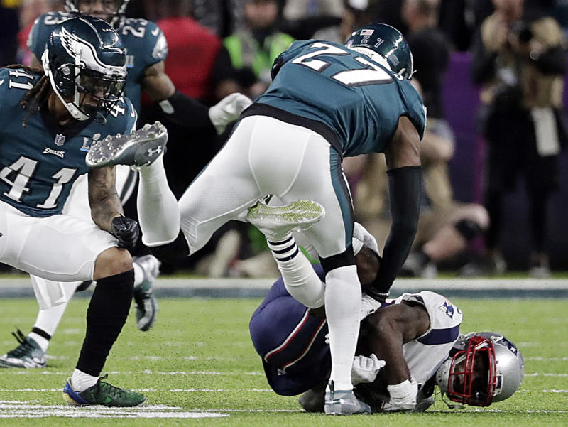 Philadelphia's Malcolm Jenkins delivers a hit to New England wide receiver Brandin Cooks in February's Super Bowl. (AP)