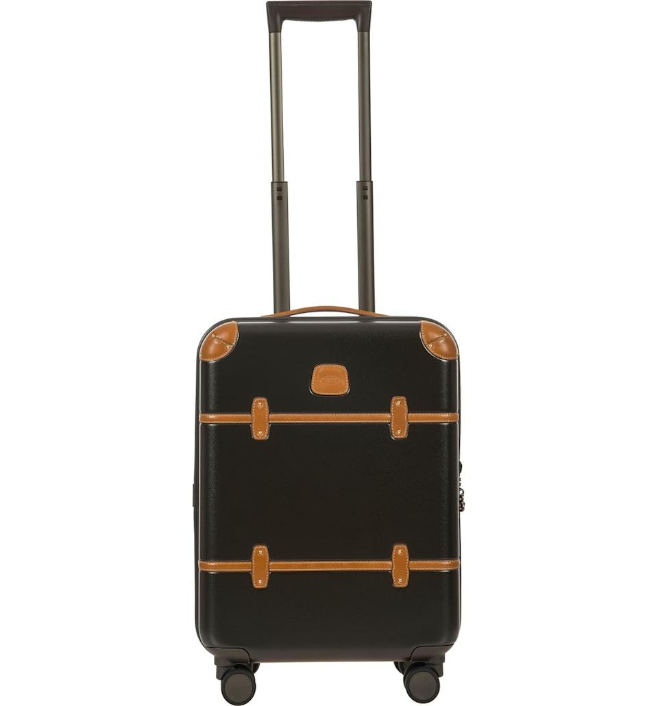 <p>Pack everything you need in this <span>Bric's Bellagio 2.0 21-Inch Rolling Carry-On</span> ($595) without worrying about the weight limit. Plus, we love the black with brown trim.</p>