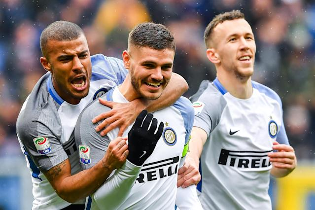 Inter's Mauro Icardi celebrates with his teammates, Alcantara Rafinha, left, and Ivan Perisic, right, after scoring his fourth goal during the Italian Serie A soccer match between Sampdoria and Inter at the Luigi Ferraris Stadium in Genoa, Italy, Sunday, March 18, 2018. (Simone Avreda/ANSA via AP)