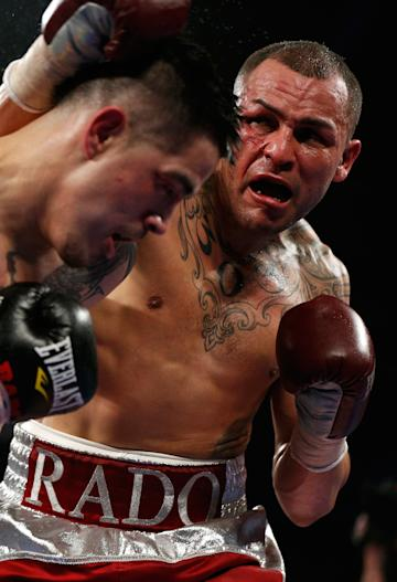 Mike Alvarado (R) desperately needs a win as he goes into his Jan. 24 rubber match in Denver against Brandon Rios (L). (Photo by Josh Hedges/Getty Images)