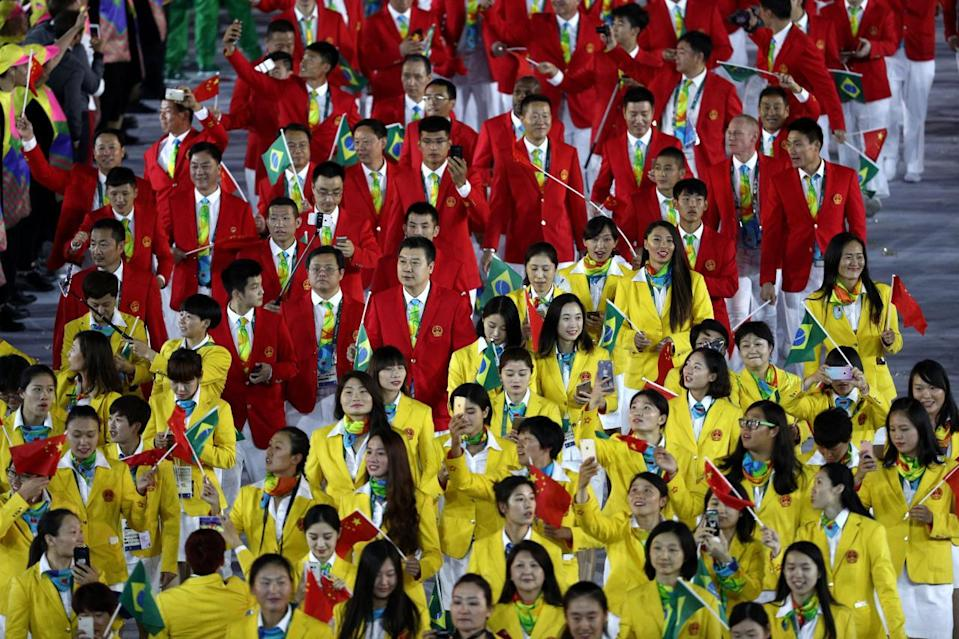 <p>China's uniforms conjured up food products, not fashion. The garish gold jackets made the women look like eggs, and the crimson menswear turned the guys into tomatoes. </p><p><i>(Photo: Getty Images)</i><br></p>