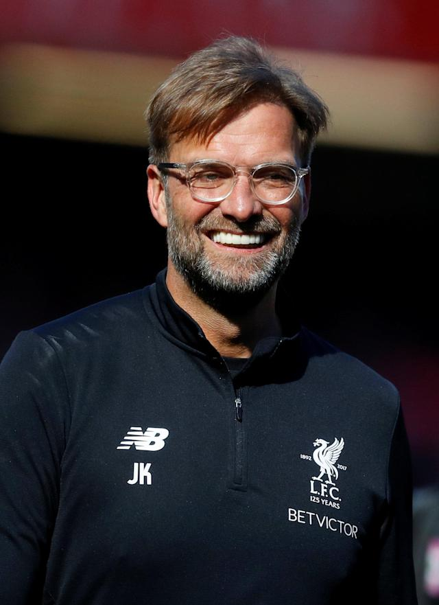 "Soccer Football - Premier League - Liverpool vs Brighton & Hove Albion - Anfield, Liverpool, Britain - May 13, 2018 Liverpool manager Juergen Klopp celebrates after the match REUTERS/Phil Noble EDITORIAL USE ONLY. No use with unauthorized audio, video, data, fixture lists, club/league logos or ""live"" services. Online in-match use limited to 75 images, no video emulation. No use in betting, games or single club/league/player publications. Please contact your account representative for further details."