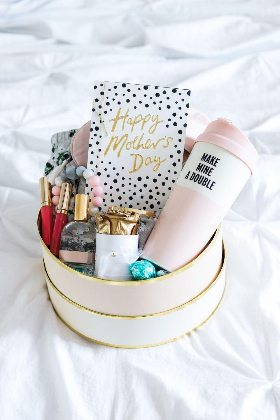"<p>If it's a first Mother's Day (or even, if she's a mom-to-be), fill a box with everything she needs to unwind, recharge, and well, stay sane. </p><p><em><a href=""https://www.ashleybrookenicholas.com/2018/04/new-mom-survival-kit-mothers-day-gift-idea.html"" rel=""nofollow noopener"" target=""_blank"" data-ylk=""slk:Get the tutorial at Ashley Brooke Nicholas »"" class=""link rapid-noclick-resp"">Get the tutorial at Ashley Brooke Nicholas »</a></em> </p><p><strong>RELATED:</strong> <a href=""https://www.goodhousekeeping.com/holidays/mothers-day/g4302/first-mothers-day-gifts-for-new-moms/"" rel=""nofollow noopener"" target=""_blank"" data-ylk=""slk:The Best First Mother's Day Gifts"" class=""link rapid-noclick-resp"">The Best First Mother's Day Gifts </a></p>"