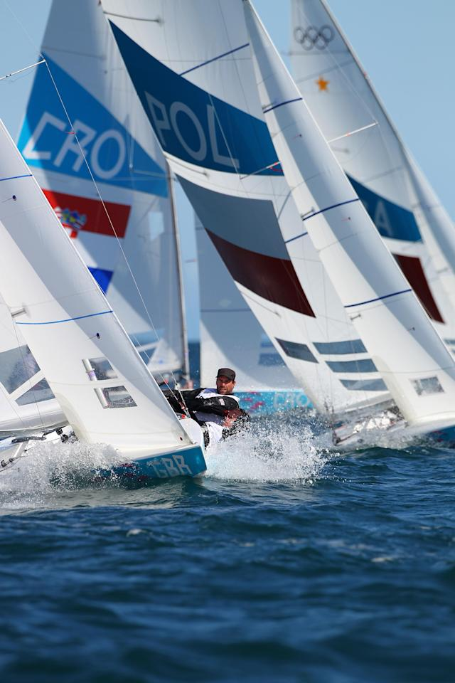 WEYMOUTH, ENGLAND - JULY 29: Iain Percy and Andrew Simpson of Great Britain in action sailing the Star class during the London 2012 Olympic Games at the Weymouth & Portland Venue at Weymouth Harbour on July 29, 2012 in Weymouth, England. (Photo by Richard Langdon/Getty Images)