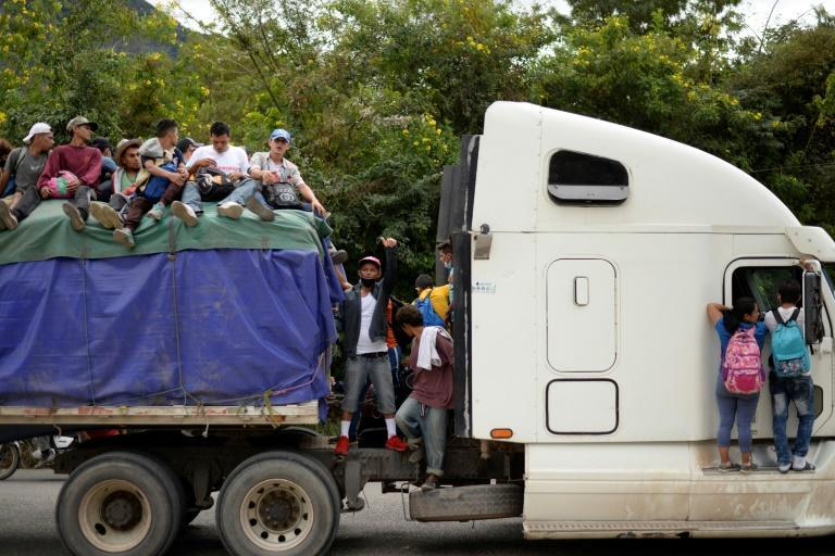A group of Honduran migrants, part of a caravan of some 6,000 trying to reach the United States, get a ride northward on a truck in Camotan, Guatemala on January 16, 2021